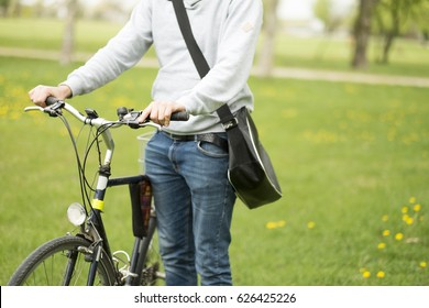 Handsome student man with retro bike