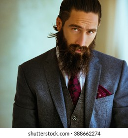 Handsome stylish bearded cool man posing, closeup