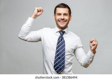 Handsome stylish businessman on grey background