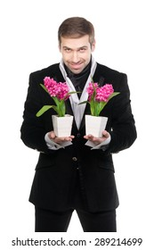 Handsome stylish man presenting flowers. Isolated over white background