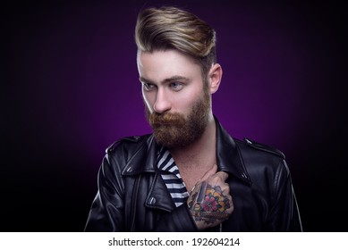 92e0f171b Handsome stylish young man. Brutal man with a beard and tattoo