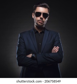 Handsome stylish young man. Brutal man with a beard and sunglasses