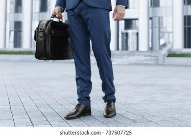 Handsome successful businessman in elegant suit outdoors