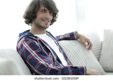 handsome successful guy sitting on the couch.