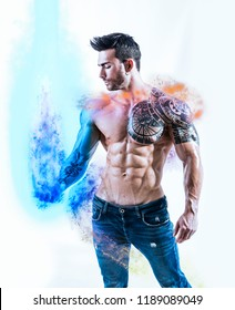 Handsome tattooed shirtless man holding illusion of blue energy light in his hand, isolated on white background