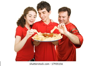 Handsome teen boy serves chips at a football party.  Isolated on white.
