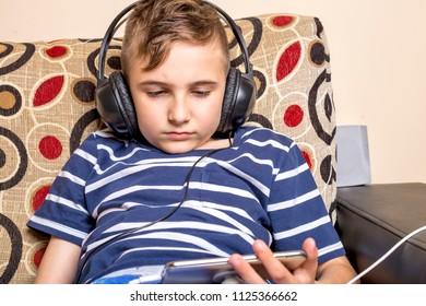 Handsome teenage boy with headphones over head