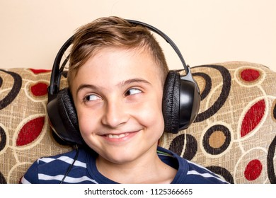 Handsome teenage boy with headphones over head