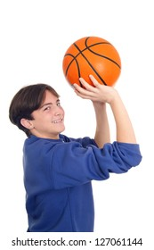 Handsome teenager throwing basketball isolated on white