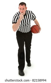 Handsome thirties basketball referee blowing whistle holding basketball.