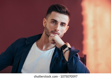 Handsome thoughtful man touching his chin. success concept