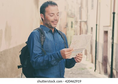 Handsome tourist man looking at map in amazing italian city, selective focus