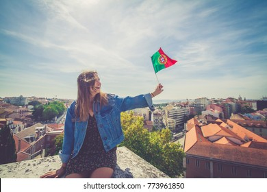 handsome tourists girl take selfie photo with view on Lisbon,Portugal from miradouro on sunny clear day holding portugal flag. romantic girl traveling to european city for holiday