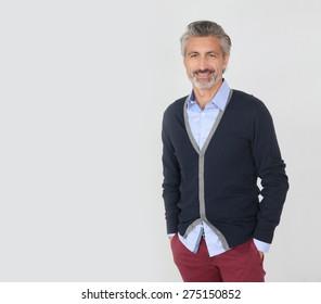 Handsome trendy mature man on grey background