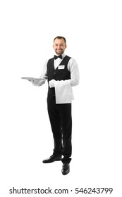 Handsome waiter with metal tray on white background