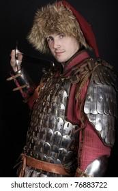 Handsome warrior holding a sword