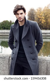 Handsome yong man in autumn coat. Outdoor fashion male portrait