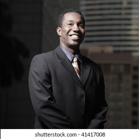 Handsome young African American executive businessman