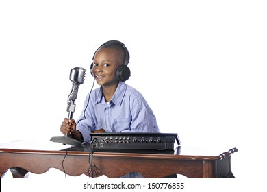 A handsome young African American happily working as a disc jockey.  On a white background.