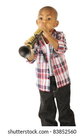 A handsome young African American tooting away on his toy clarinet.  Isolated on white.