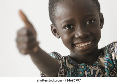 Handsome young African boy showing his thumbs up as a success sy