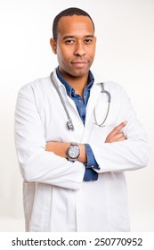Handsome young african doctor posing isolated over a white background