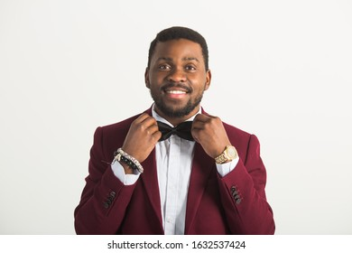 handsome young african man in a suit on a white background - Shutterstock ID 1632537424