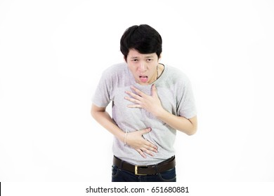 Handsome young asian man feeling sick and vomiting , he want to puke , isolated on white background