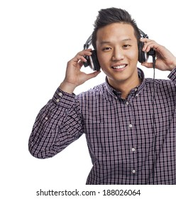 Handsome young asian man listening to music