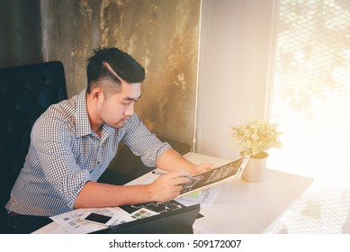 Handsome Young asian man working at work.