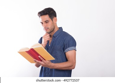 handsome young asian men reading a book isolated on white background