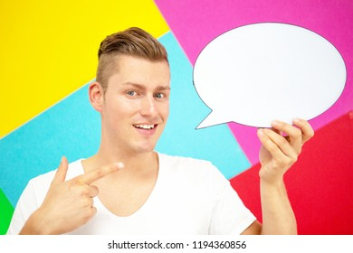 handsome young blond man holding a speech bubble