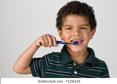 Handsome Young Boy Brushing Teeth