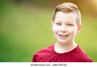 Handsome young boy outside portrait