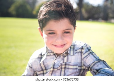 Handsome young boy in the park
