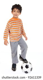 Handsome Young Boy Stands with Foot on Football, On White Background