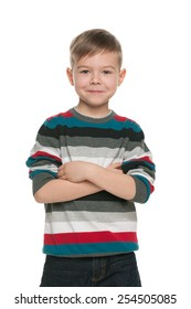 A handsome young boy stands on the white background