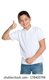 A handsome young boy in the white shirt holds his thumb up