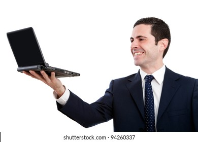 Handsome young business man in blue suit raising a laptop.Isolated on white.