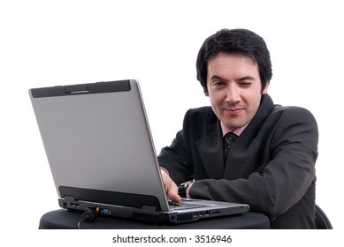 Handsome young business man working with laptop