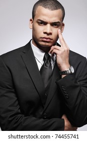 Handsome young businessman in black suit.