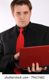 Handsome young businessman holding small netbook computer on white background
