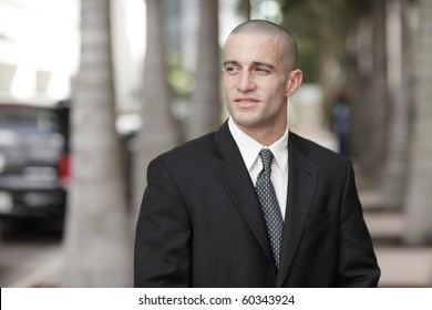 Handsome young businessman with a shaved head