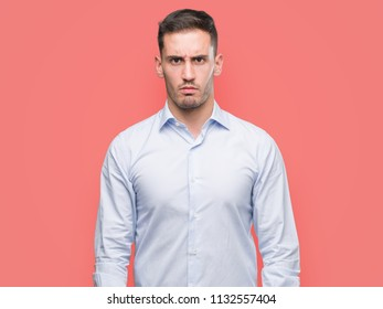 Handsome young businessman skeptic and nervous, frowning upset because of problem. Negative person.