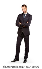 Handsome young businessman standing confident. Isolated on white. Smart boss, manager portrait with crossed arms