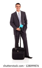 handsome young businessman with trolley bag and air ticket