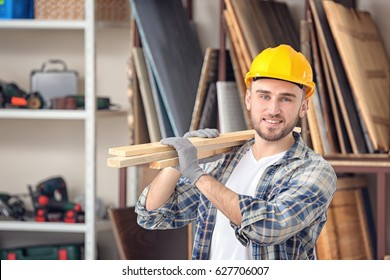Handsome young carpenter in workshop