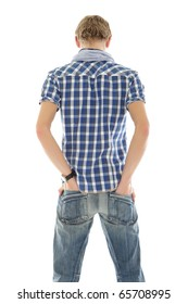 Handsome young caucasian man from back. Hands in pockets. Studio shot. White background.