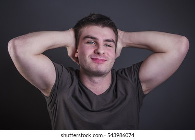 Handsome young caucasian man flexing and stretching