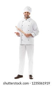 handsome young chef holding rolling pin and looking at camera isolated on white